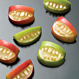 ghastly grins apples and almonds are all thats required for these apple bites you could also fill mouths with nut butter and make the teeth out of - Halloween Healthy Food